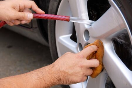 hands with hose and sponge washing blue car glass Stock Photo - 5749280