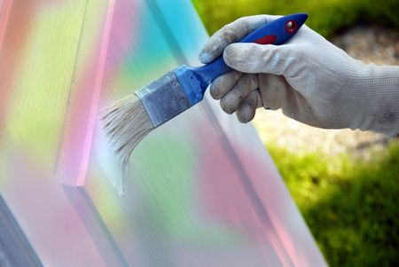 painting colorful wooden door by blue brush outdoor photo