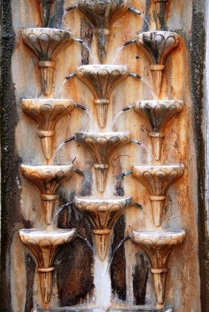split level: old stone wall rusty fountain texture outdoor Stock Photo