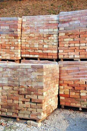stacks of packed bricks outdoor, building material photo