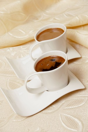 two turkish coffee in white cups on table photo