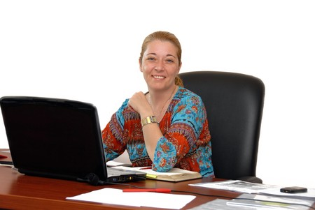 young blond woman in casual cloth at the office desk over white photo