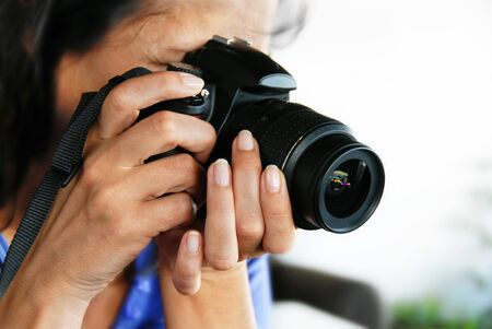 woman photographer, black camera in woman hands closeup Stock Photo