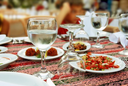 restaurant table with served plate and wine glasses photo