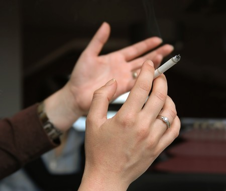 gesticulation: woman smoking, hands gesticulation with a cigarette closeup