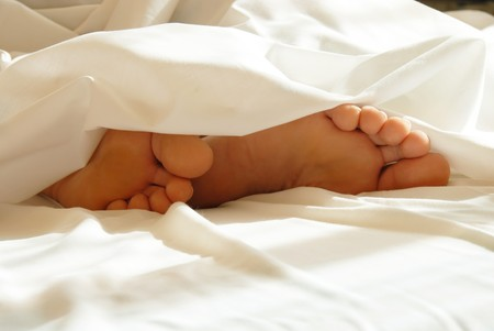 man feet: Feet in bedding