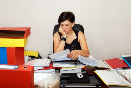 busy woman at the office desk working photo