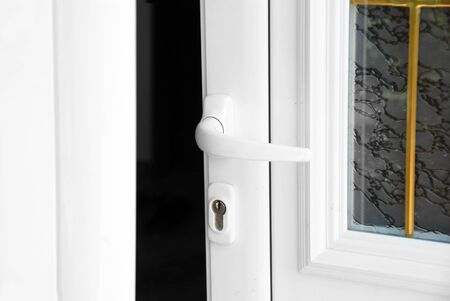 joinery: opened white door with handle closeup