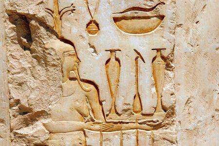 decipher: Egyptian  hieroglyphics on limestone wall in egyptian temple