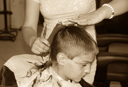 caucasian boy getting a haircut sepia tones Stock Photo - 8458336