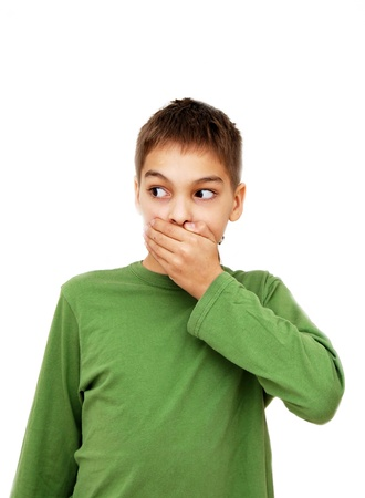 caucasian teenage boy covering his mouth by hand, isolated over white background