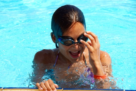 happy teen girl in blue swimming pool portrait Stock Photo - 8571788