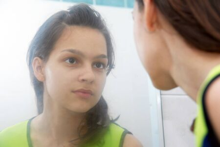 beautiful teenage girl portrait in blurred mirror Reklamní fotografie