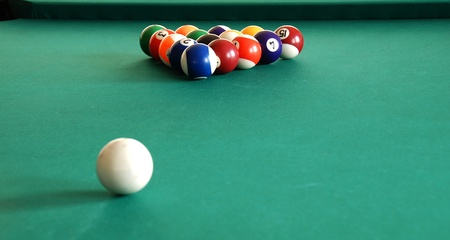 pool halls: billiards green table with balls in beginning position indoor