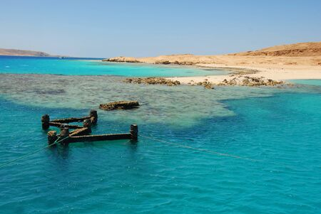 turquoise blue water with coral reef in Red sea, Egypt photo
