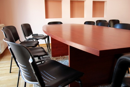 brown office meeting desk and black chairs indoor