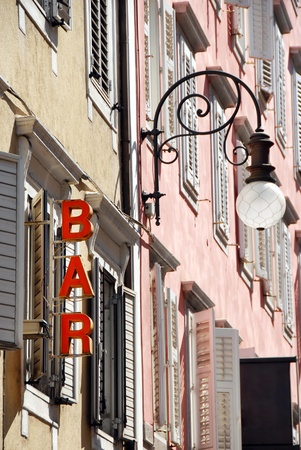 architecture detail, street lamp and bar sign  in Trieste, Italy Stock Photo - 9561240