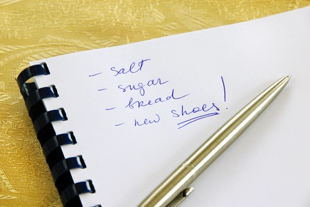 daily planner: Daily planning list for shopping in notebook with pen Stock Photo