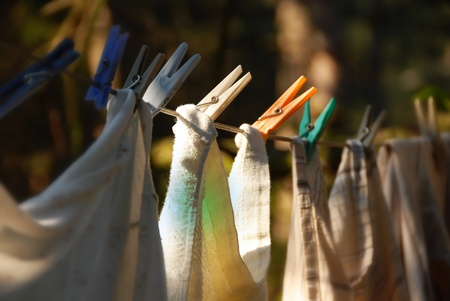 drying laundry line with clothes pegs outdoors closeup photo