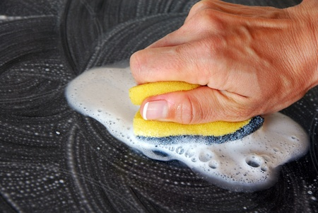 hand with a sponge cleaning surface in kitchen Stock Photo - 10323497