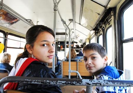 children in the city bus