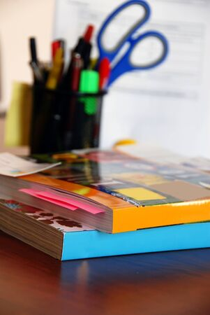 catalogs: two dense catalogs with bookmarks closeup on office desk Stock Photo