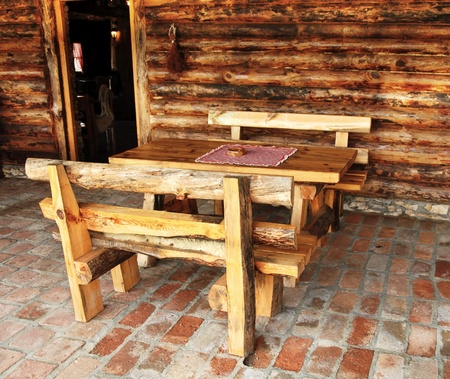 rustic wooden benches and table in rural Serbia photo