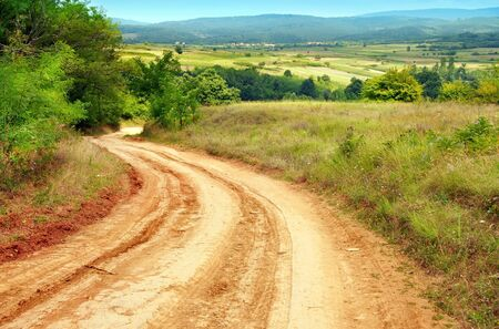 dirt road: summer rural road and landscape of central Serbia