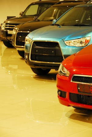 display machine: four new automobiles in raw in store