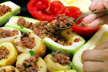 preparing fresh stuffed vegetables with minced meat photo