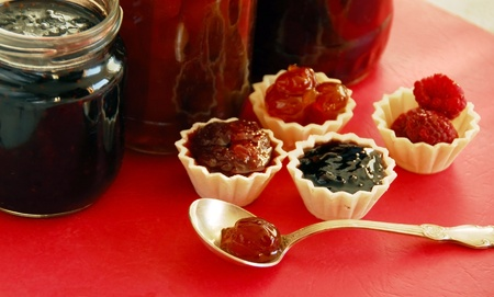 preserves,  jam in small edible treats and glass jars photo