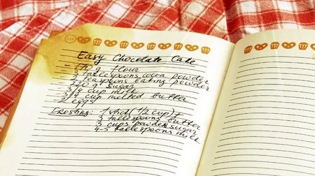 manuscrita: written recipe of easy chocolate cake in cookbook Banco de Imagens
