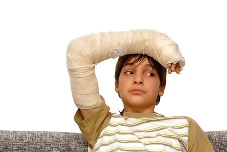 gypsum: sad teenage caucasian boy with broken arm bone Stock Photo