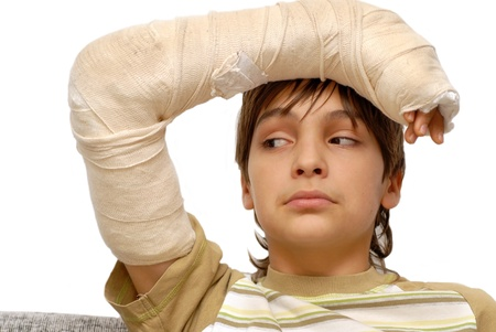 sad teenage caucasian boy with broken arm bone Reklamní fotografie