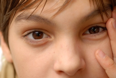 caucasian boy portrait, beautiful brown eyes closeup macro photo