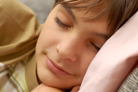 caucasian boy portrait, sleeping with arm under cheek photo