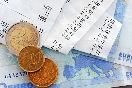 economize: closeup of bills and euro banknotes and coins macro Stock Photo