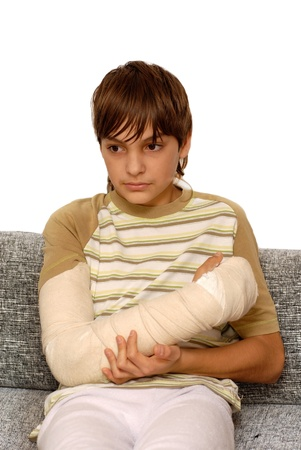 sad teenage caucasian boy with broken arm bone Standard-Bild