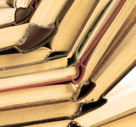 old dusty opened books stack on table, sepia toned Stock Photo - 12034047
