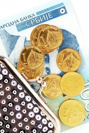 vaus serbian dinars coins over hundred banknote and silver purse Stock Photo - 12467260