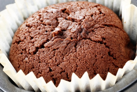 souffle: fresh baked chocolate souffle in paper cup closeup Stock Photo