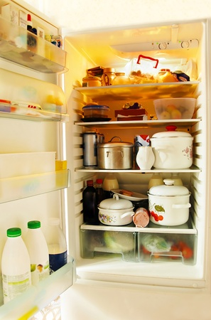 opened refrigerator inside full of various foodstuff Stock Photo - 12467204