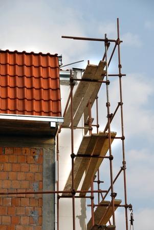 Scaffolding on building corner on construction site photo