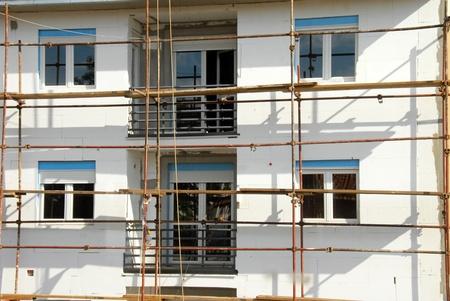 Scaffolding on building facade photo