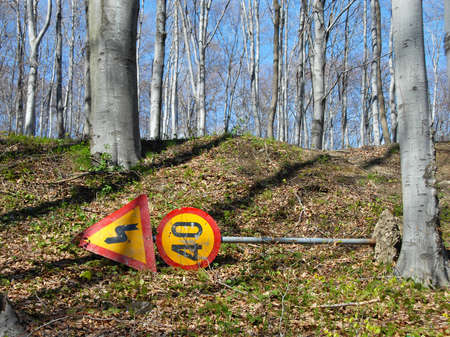kilometre: removed traffic signs in spring park between trees Stock Photo