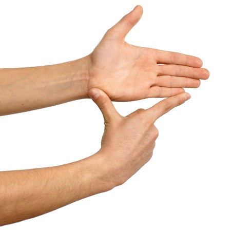 inches: isolated hands showing measure over white background