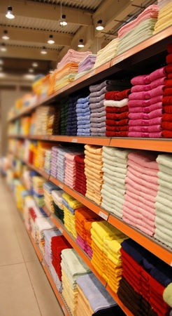 new colorful towels stacks on shelves in store Stock Photo - 13320639