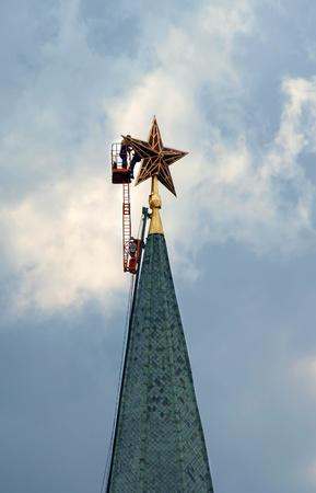 kremlin: workers repairing the Kremlin tower star in Moscow, Russia