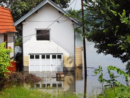 house surrounded by water in river during spring flood in Serbia Stock Photo - 13336594