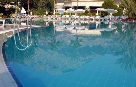 swimming pool at mediterranean summer resort hotel in Turkey photo